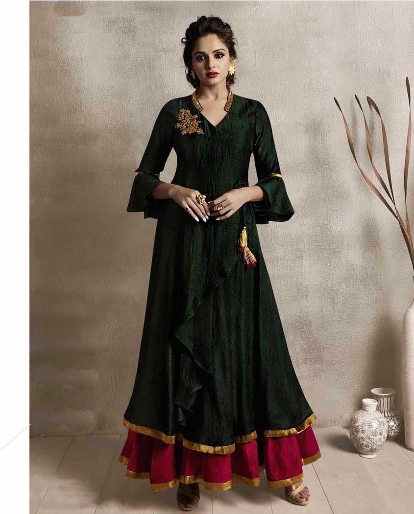 493c9326b2 Here is a very pretty designer readymade double layered gown in dark green  and rani pink colour. This kurti is fabricated on satin linen which gives a  rich ...