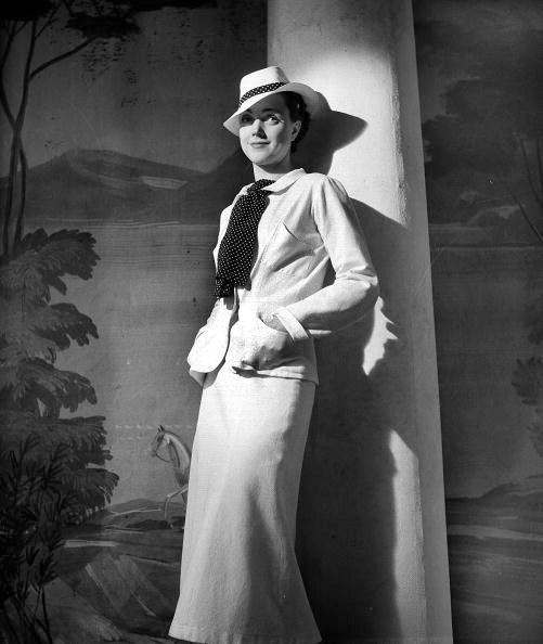 Chanel Vintage Fashion Photography: Model Is Wearing A Tailored Suit By Chanel, One Of Her