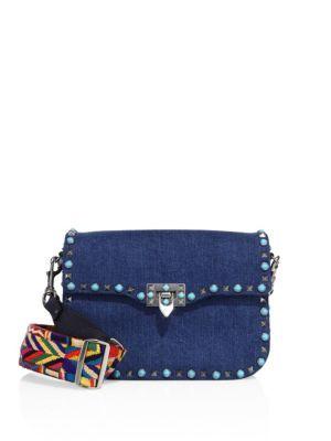 aa89f7162839b VALENTINO Rockstud Rolling Denim Guitar-Strap Shoulder Bag.  valentino  bags   shoulder bags  lining  denim  cotton