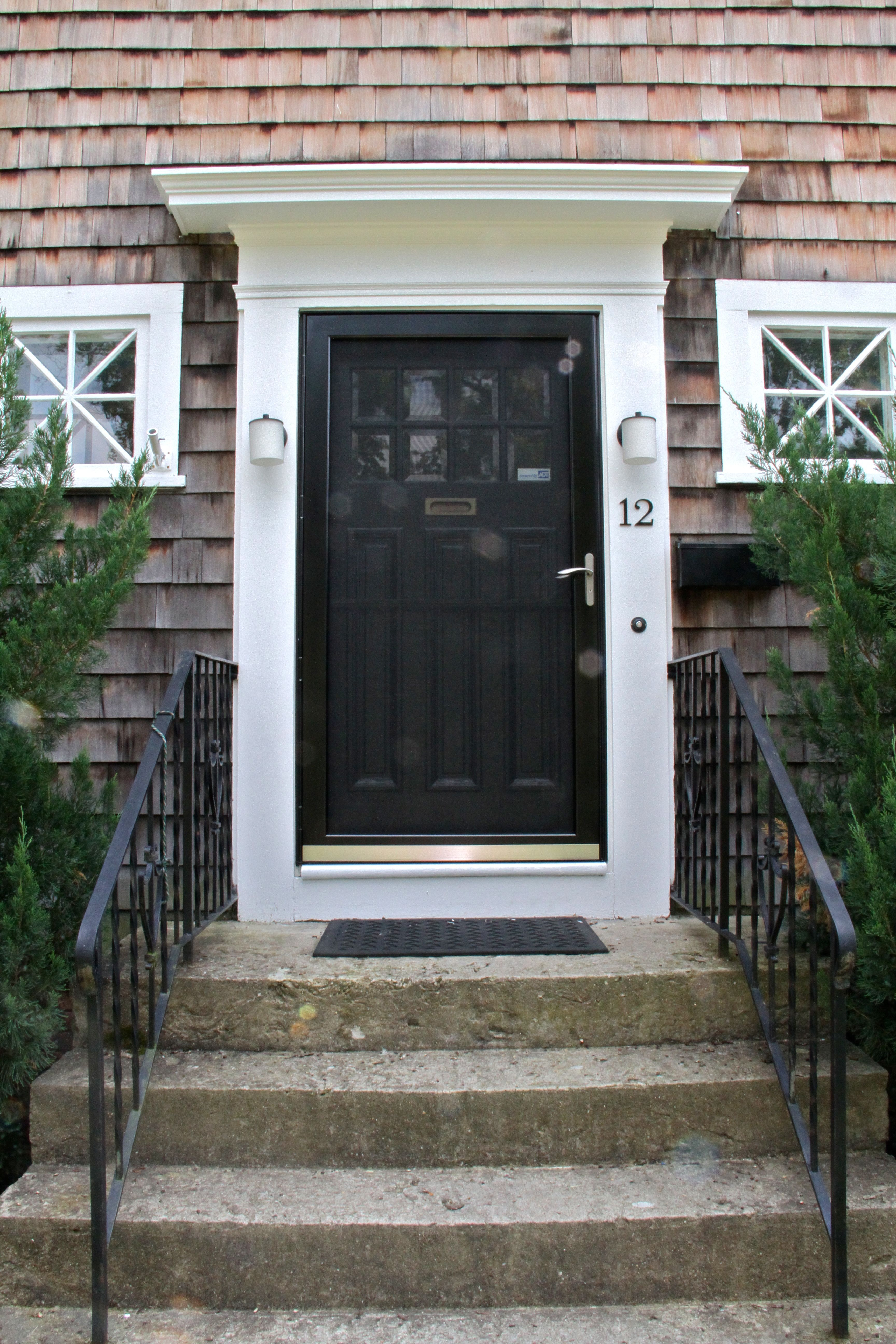 Black Front Door With White Storm Door After The Front