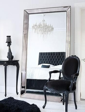 #17BestRoomEver. Elegant black bedroom decor. I love the large mirror and the black bold furniture really stand out! This would be great for trying on clothes! oh and hey theirs my head board in the mirror imagine that!
