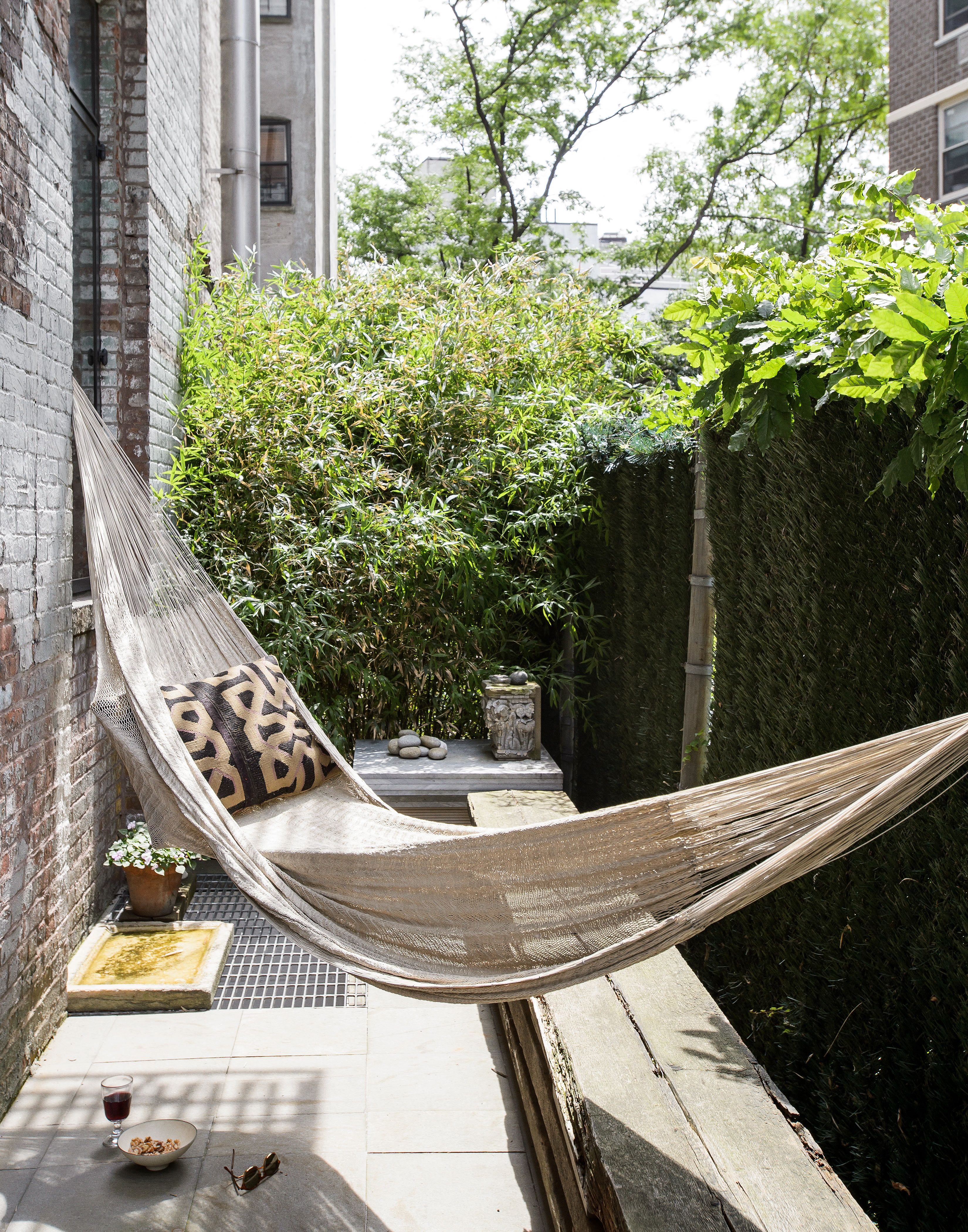Being clever is key with small outdoor spaces, this hammock ...