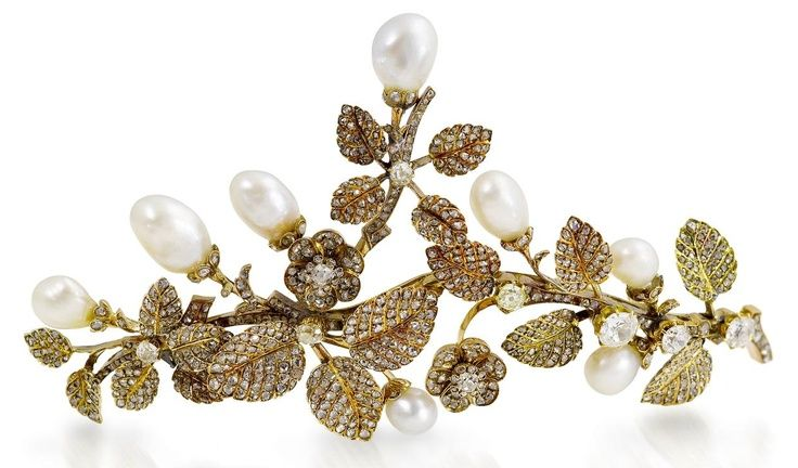A gold, diamond and baroque pearl tiara, 1900. Designed as a series of wild roses and their leaves, with baroque pearls as fruits. This piece used to grace the site of S J Phillips.