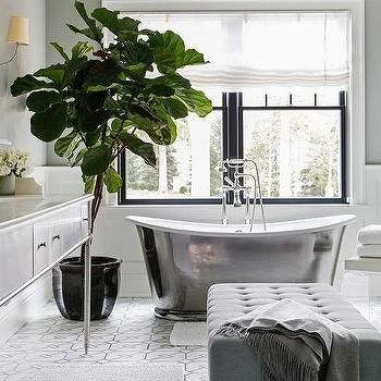 white and gray master bathroom with lucite bench