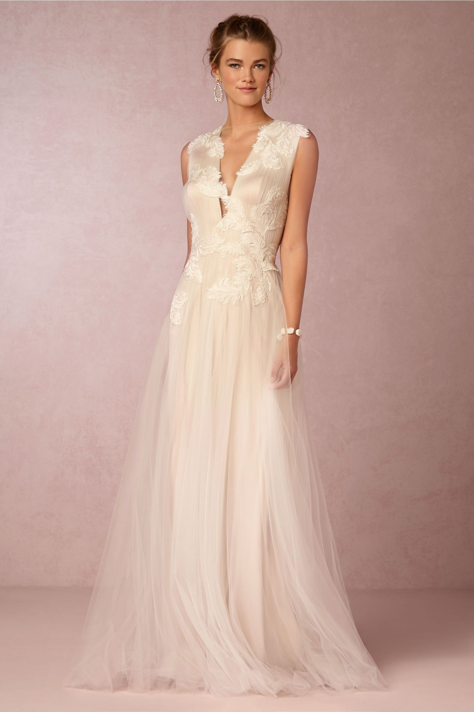 rosemary sleeveless blush tulle wedding gown showcasing a plunging v