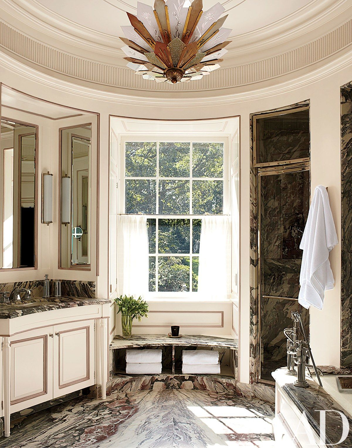 The master bath is sheathed in fior di pesco apuano marble the