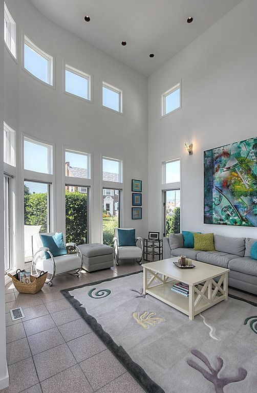 Superieur Feel At Ease While Lounging In This High Ceilinged Living Room. Contemporary  ...