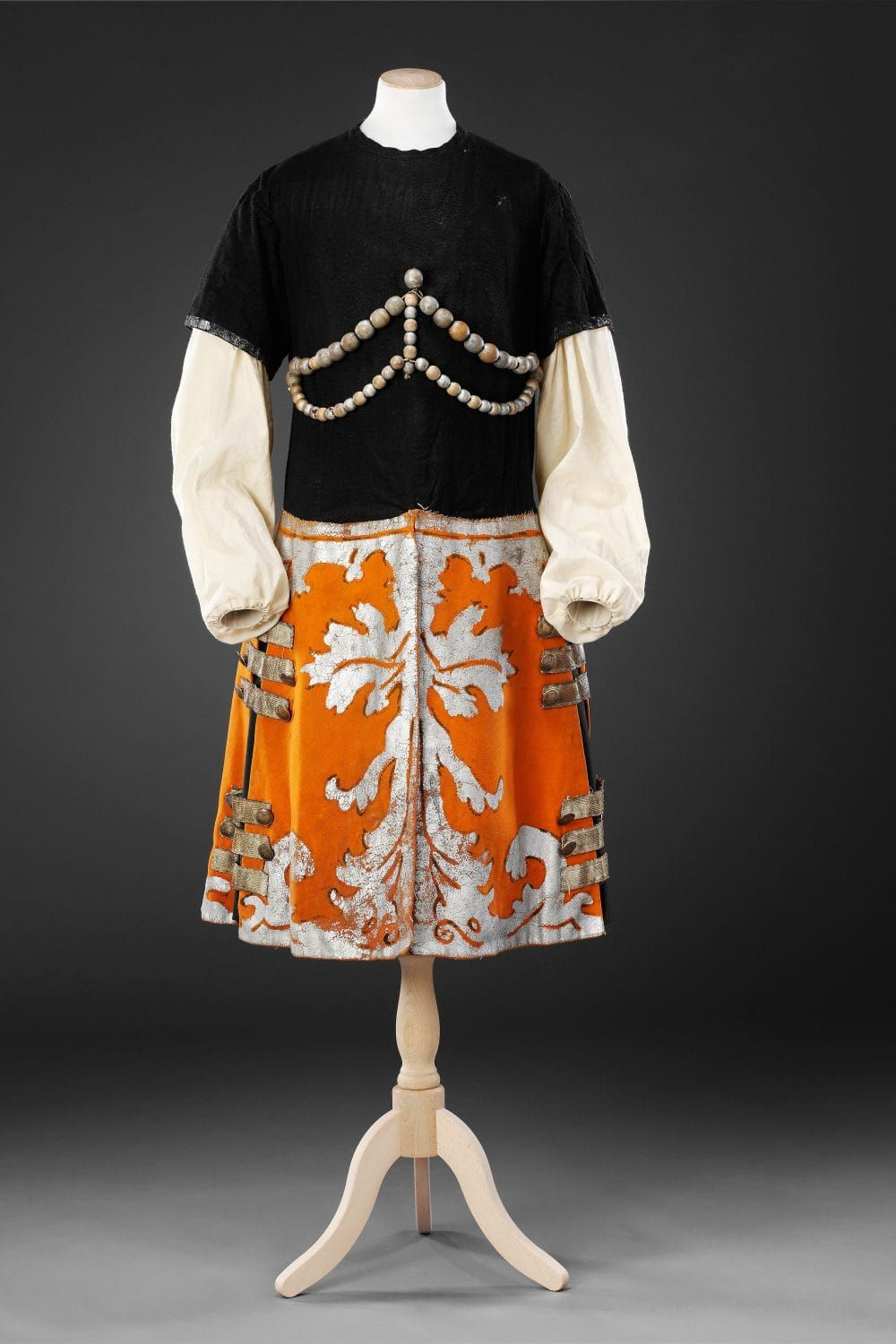 thejohnbrightcollection.co.uk: bright skirt, high neckline top, big sleeves, bright colored skirt.