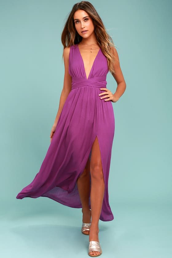 Hold on tight to the Passionate Embrace Magenta Halter Maxi Dress! Breezy woven rayon falls from a tying halter neckline, into a backless bodice. Elasticized waist tops a cascading maxi skirt with side slit.