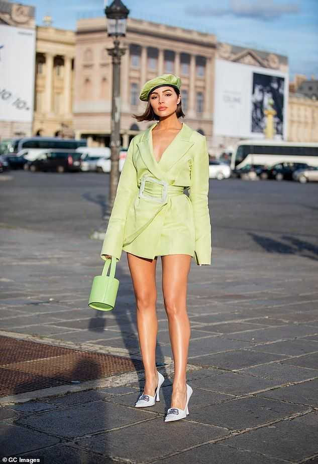 Photo of Olivia Culpo poses up a storm in dazzling sheer mini dress in Paris
