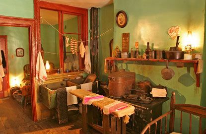 """THE LOWER EAST SIDE TENEMENT MUSEUM The Lower East Side Tenement Museum has meticulously restored several apartments of an 1863 tenement building to capture the cramped living conditions and personal histories of the Lower East Side. These time capsules are accessible through hour-long guided tours, such as """"Piecing It Together,"""" which displays the apartment and garment workshop of two Jewish families at the turn of the twentieth century. Other tours recreate the lives of an Irish family, a…"""