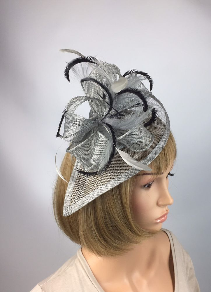 Striking hat and bow fascinator complemented by beautiful feathers on a  curved teardrop.  9341e0907e1