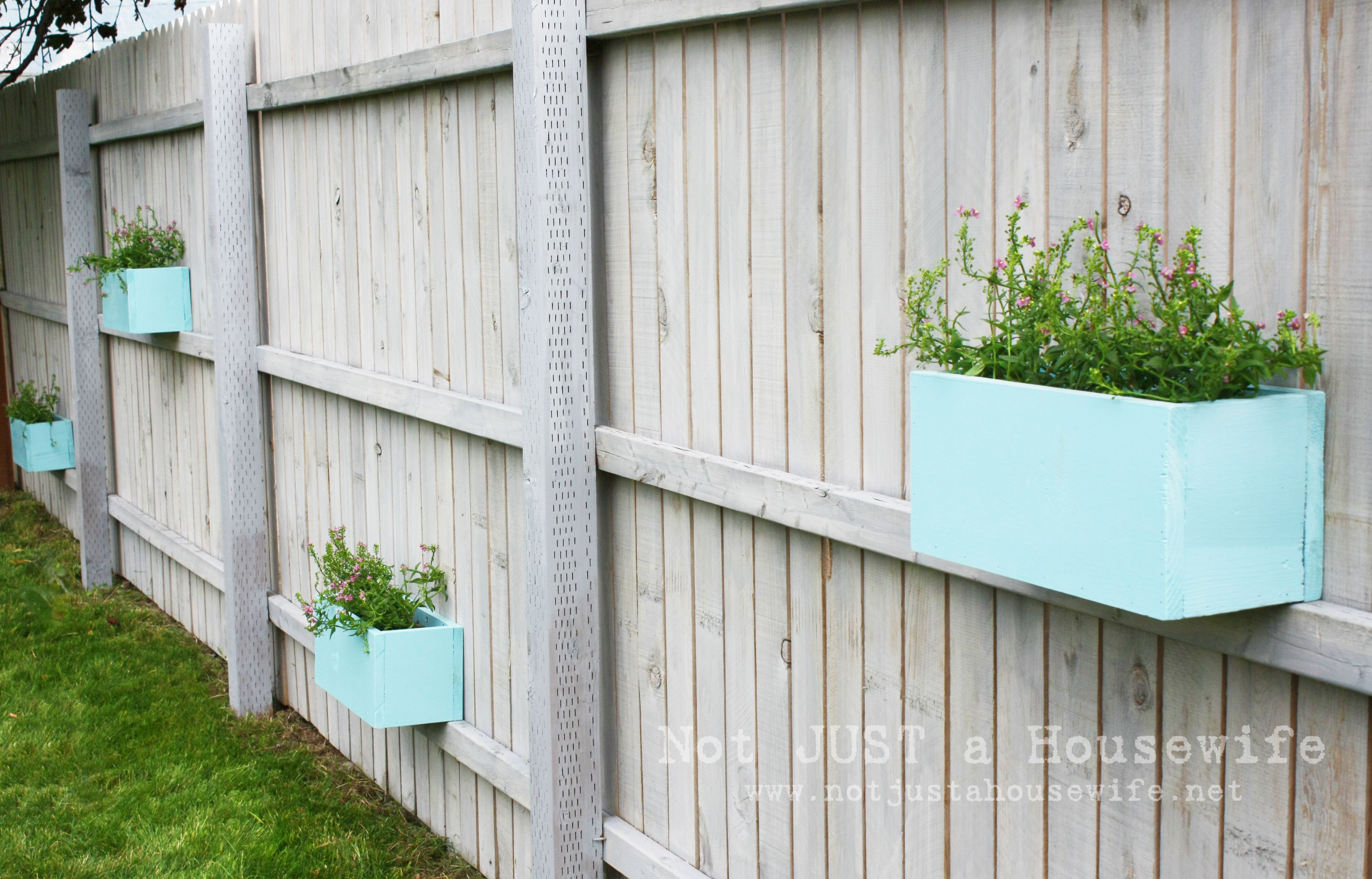 Exterior Blue Color Planter Box On Fence With Grey Wooden Painted Backyard Make Your Extraordinary Our Decor Ideas Yard Fencing