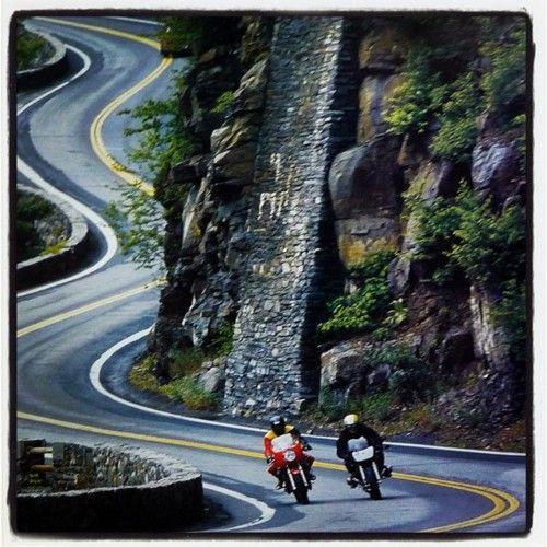 Motorcyclists On A Winding Road Somewhere On A Montainous