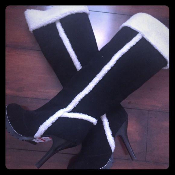 Swiss vanilla faux fur lined Boots size 6 Swiss vanilla black/white faux fur lined boots size 6 nwt Swiss vanilla Shoes