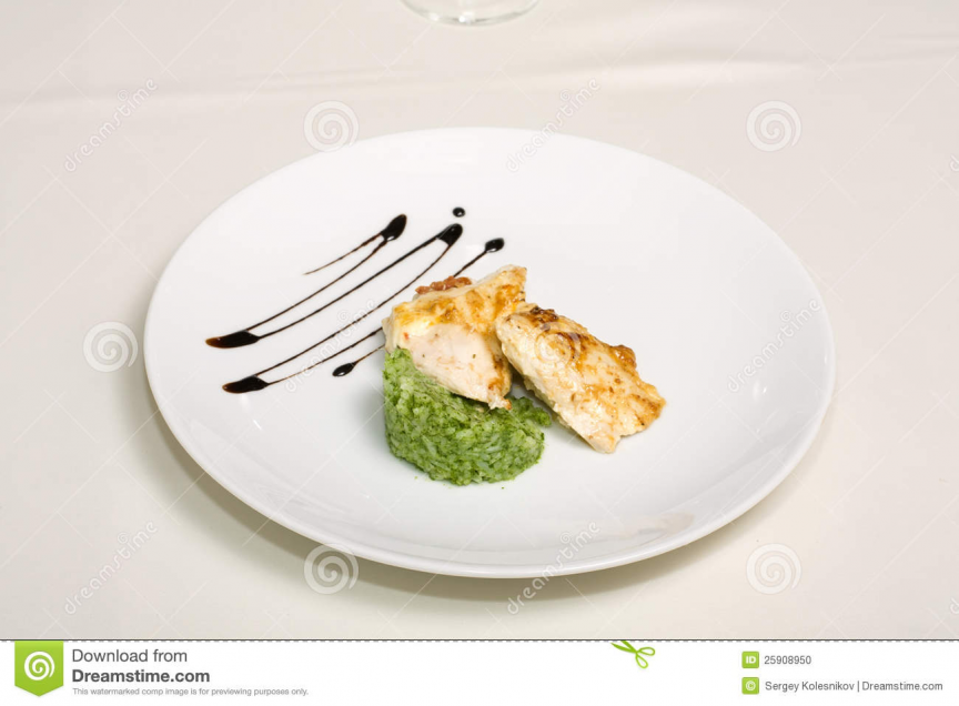 Baked chicken with side dishes of rice on a platter closeup.