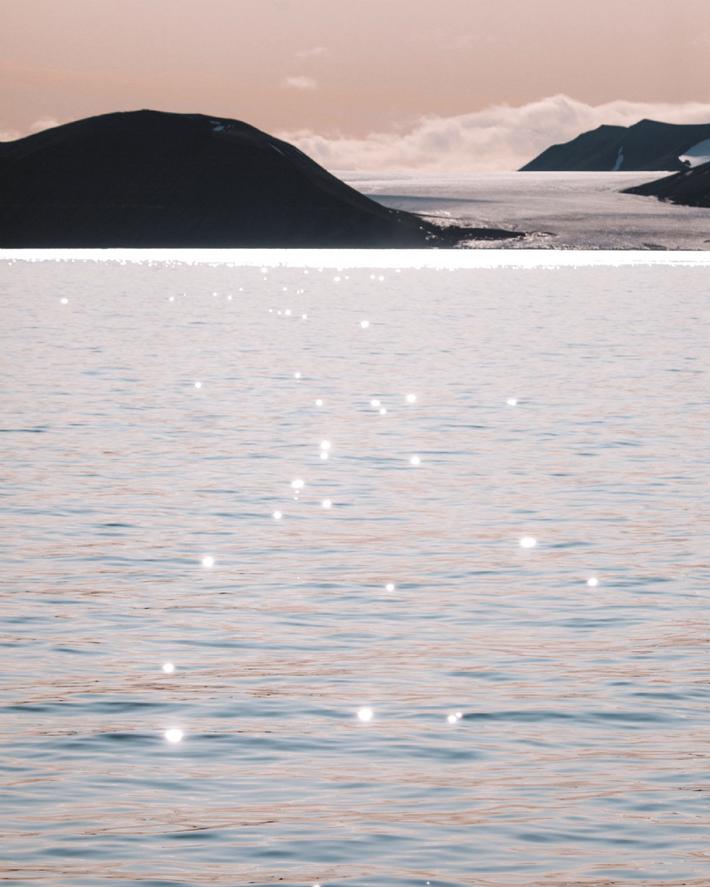Pastel colors of Svalbard before sunset over the water in winter with a glacier via @finduslost | Looking to make photography editing easier? Our Adobe Lightroom Presets (mobile presets and desktop presets) Winter Collection is a series of 6 custom presets (photo filters) that will make your photography stand out. Shop now. #photography101 #photographytips #photoediting #photopresets #finduslost