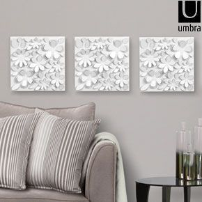 Bring your wall to life with the Umbra Wallflower décor set! This set of 25  white wall flowers adds an extra dimension to your interior, lending  texture and