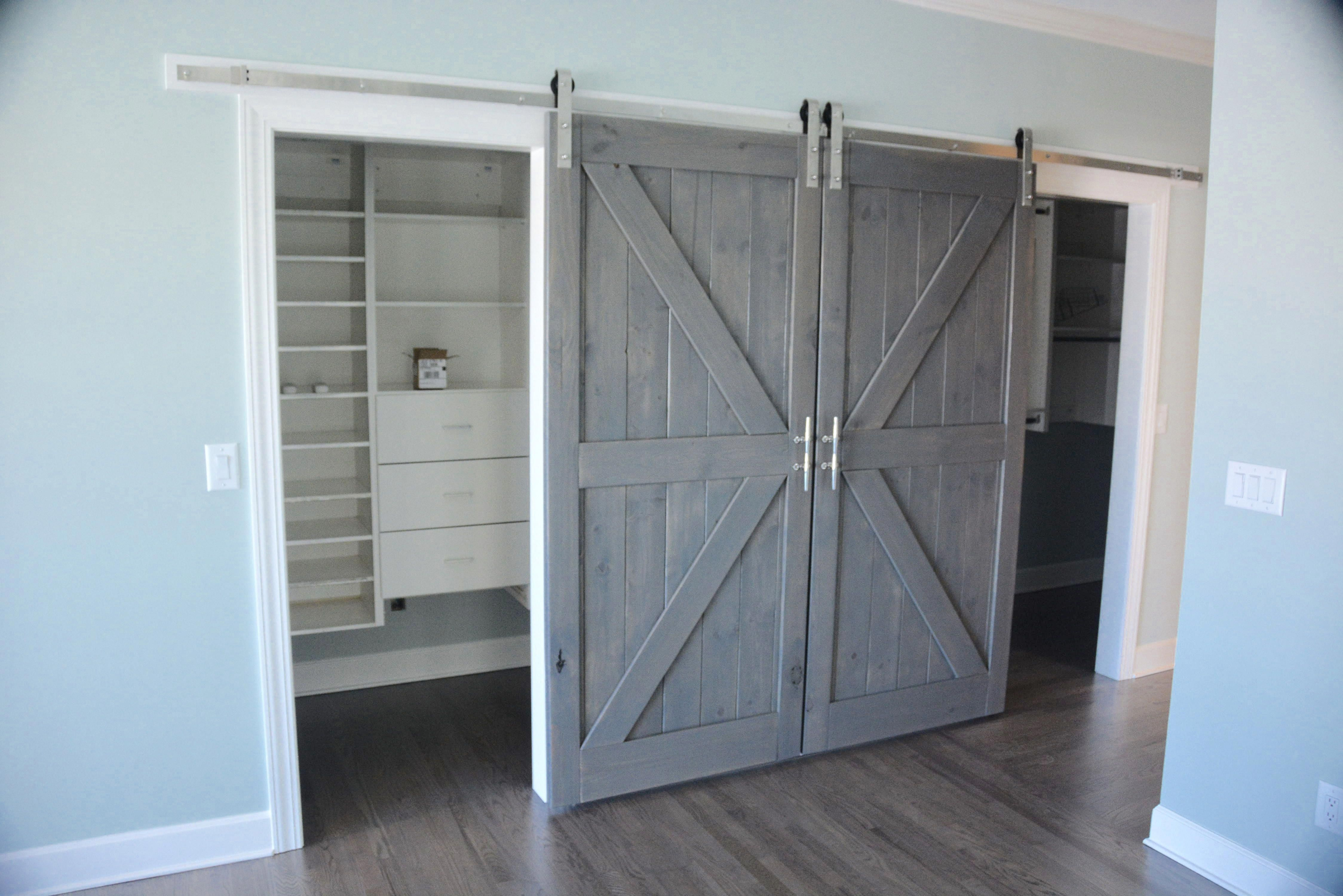 British Brace Sliding Barn Doors With Grey Stain The Hardware Was Stainless Steel With Boat Cleats As Handles Built In C Indoor Barn Doors Interior Barn Doors