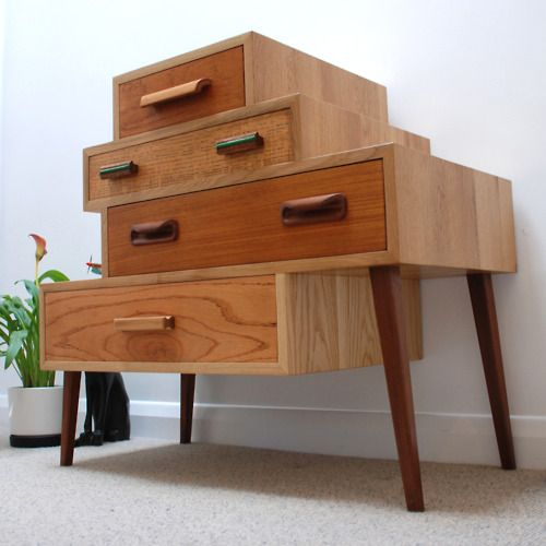 Yes The different wood finishes and slanted legs make this retro