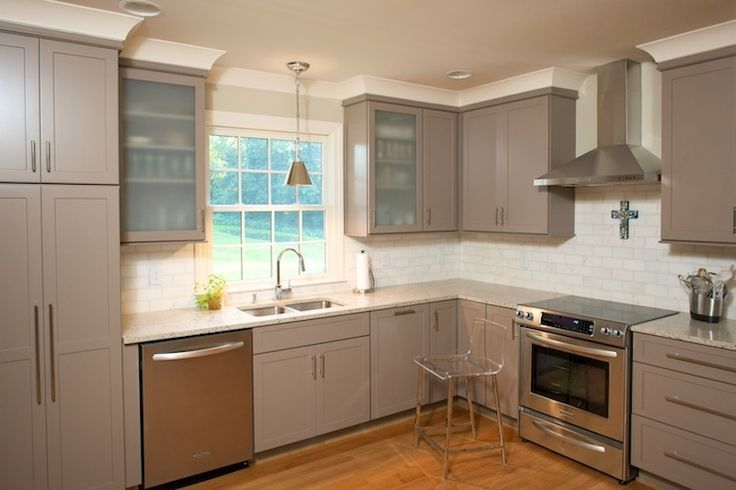 Looks kind of like our kitchen.. taupe color subway tile ...