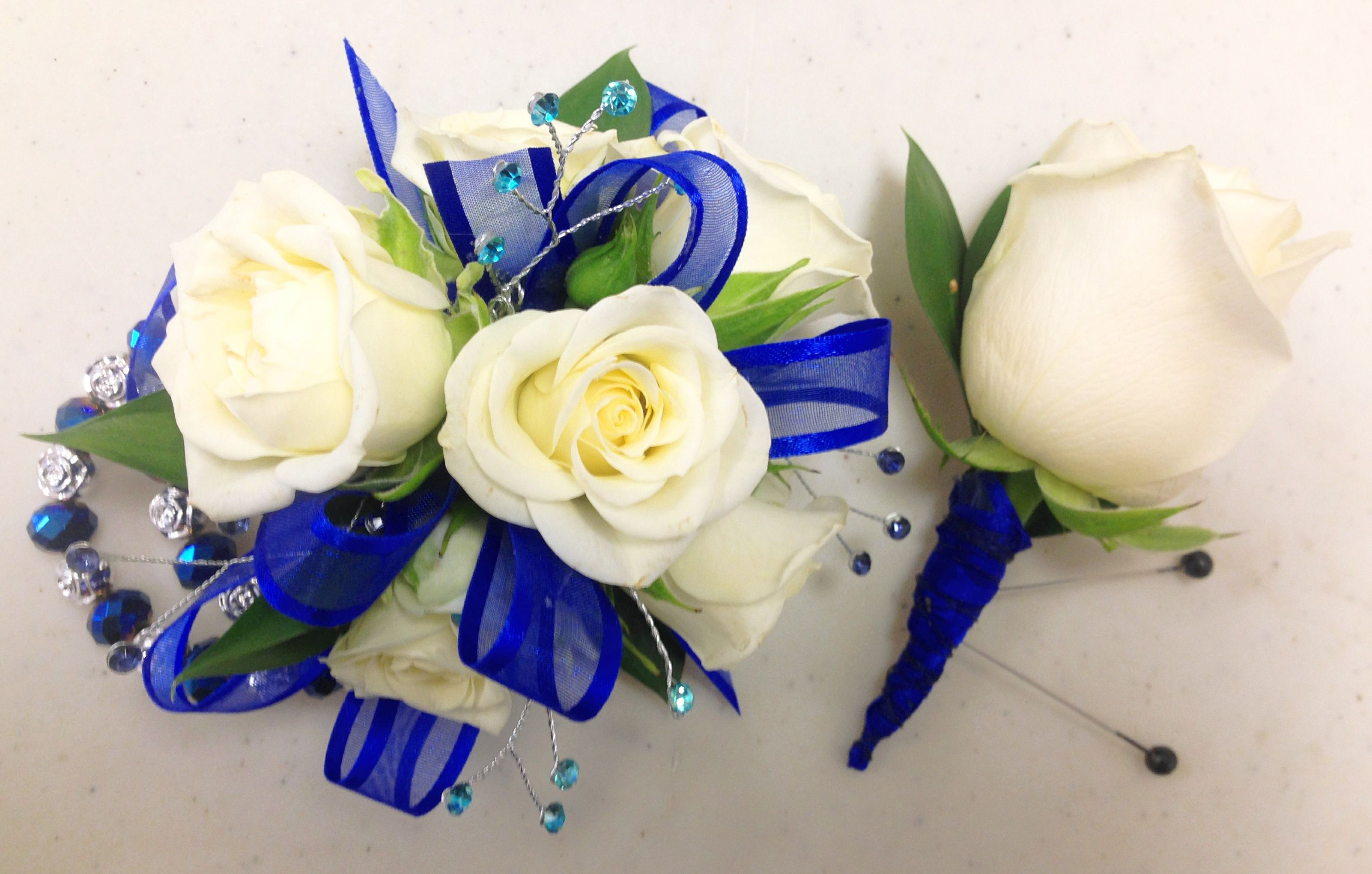 Royal blue and cream are stunning in this corsage with keepsake royal blue and cream are stunning in this corsage with keepsake bracelet izmirmasajfo Gallery