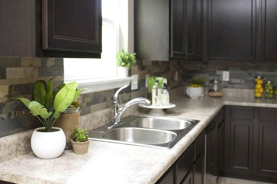This Faux Stone Kitchen Backsplash is the