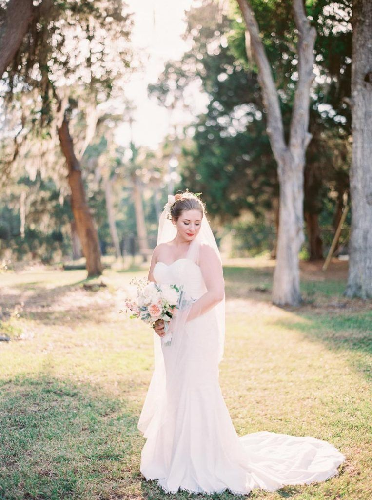Photo of Vintage Travel-Inspired Wedding at The Ribault Club in Fort George Island, FL – The Celebration Society
