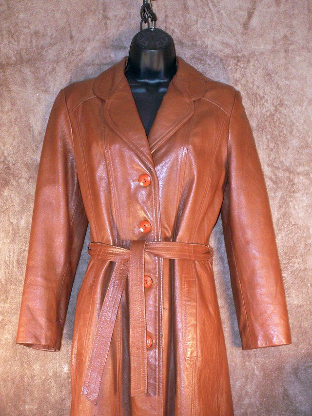 "Vintage Long Leather coat by Winners Circle Fashion   outstanding Long leather coat calf length for most  duster style w/tie belt n flared skirt  looks great with boots esp  45"" long  16"" cross shoulders  23"" sleeve length  id say for SMALL lady   Beautiful long leather coat.  shows slight wear and been stored, still great condition  fully lined and one beautiful coat with a matching tie belt  questions ask...  will post more pics …"