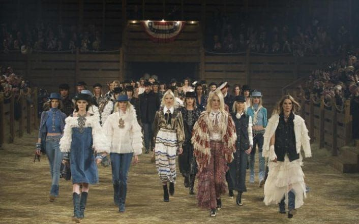 Rodeo time: In December 2013, it was off to  Texas for the Metiers d'Art show. A bonafide rodeo's sawdust floor became the stage for a bevy of Americana-clad models.