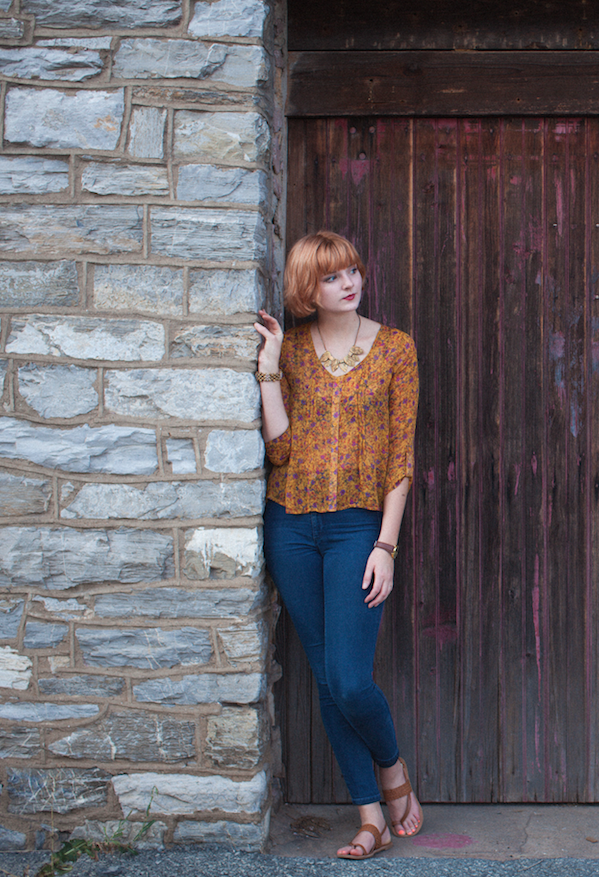 Heather F. of ModCloth such a great photo! Love the rustic stonework. Your hair is gorgeous, and that blouse really compliments it!