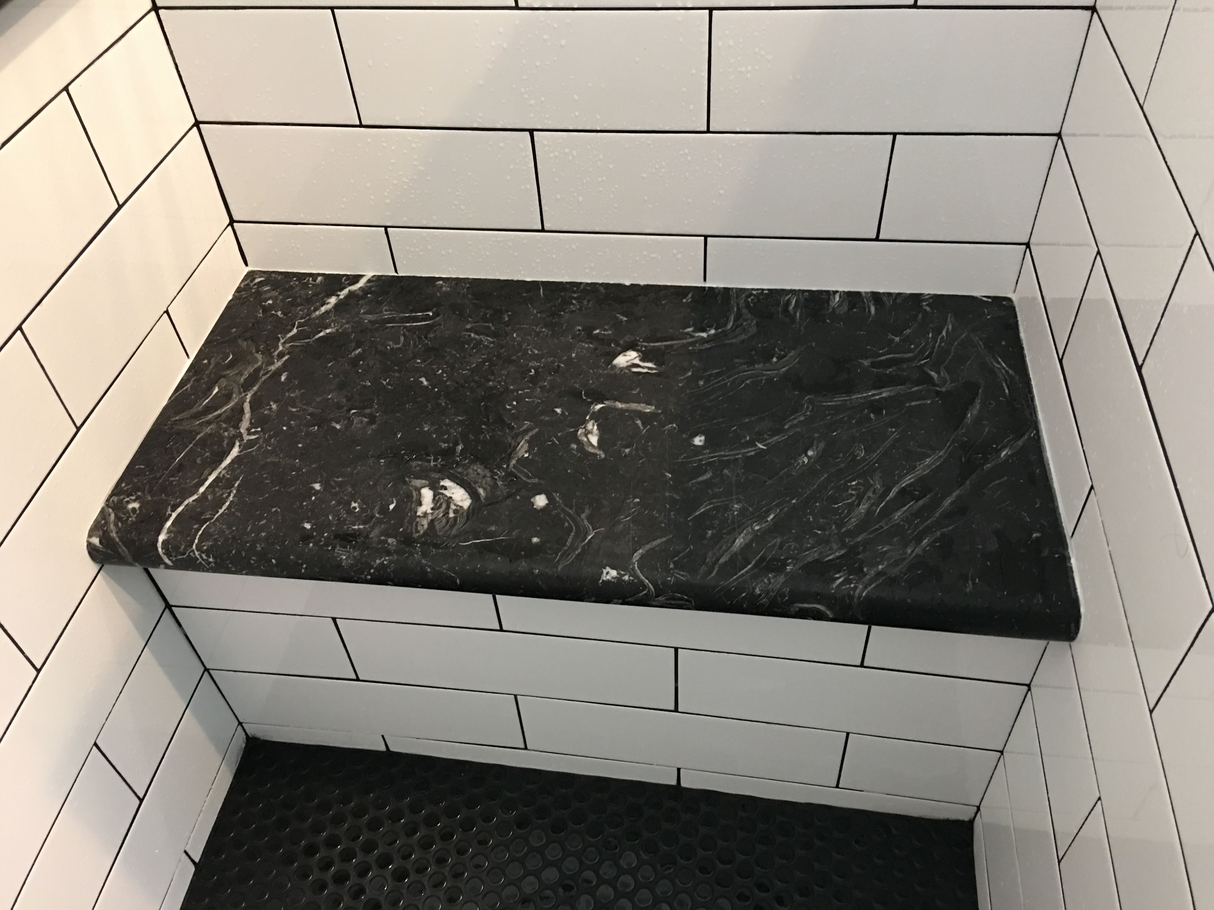 Shower Bench With Marble Seat And Matte Black Penny Round Floor Tile Marble Is Negra Marquina Venato Marble Shower Tile Tile Bathroom Black Tile Bathrooms
