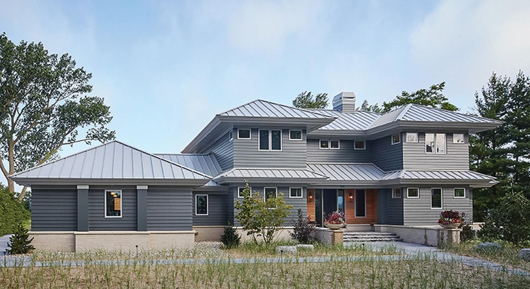 Designed With The Modern Family In Mind This Sleek Home From Visbeen Arc Farmhouse Style House Plans Country Style House Plans Modern Contemporary House Plans
