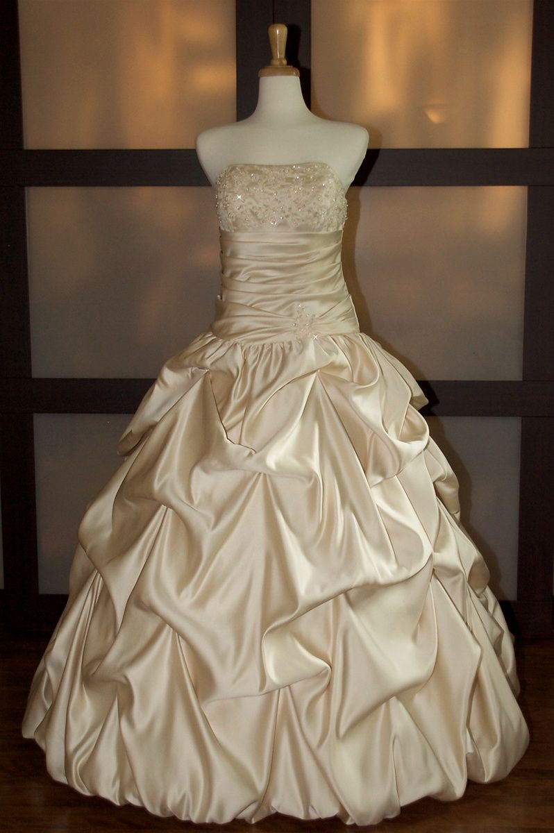 Pretty satin wedding dress with puffed bottom wedding style