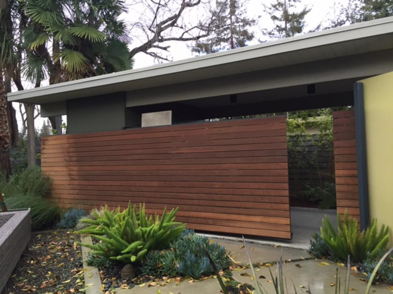 Mid Century Modern Courtyard With Sliding Ipe Fence Ipe Wood