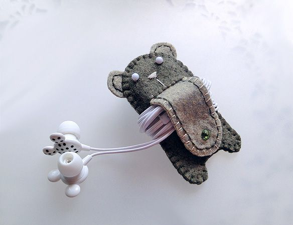 You can keep your earphones cable neat and tangle free.     You just wind around the stomach of this medium size bear and secure it with a button a...