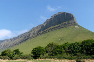 Benbulben Benbulben was formed during the Ice age, when large parts of the Earth were under glaciers. It was originally merely a large ridge, however the moving glaciers cut into the earth, leaving a distinct formation, now called Benbulben. The smoother sides are composed of Benbulben shale. These rocks formed in the area approximately 320 million years ago. Sligo Tourism Office do not recommend climbing Benbulben. There is however a looped walk around Benbulben and Sligo Tourism Office can