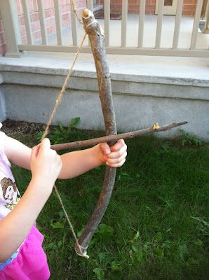 Making Bows and Arrows out of sticks, imaginary play inspired by the movie Brave.