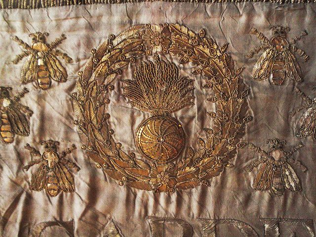 Gold embroidery on silk - wreath with artillery emblem plus Napoleon's bees.