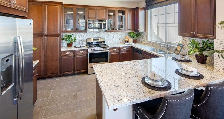 Glass Fronted Cabinets Are A Memorable Touch In This Sleek Kitchen Residence One A New Home Built By Woodside Homes The Sleek Kitchen Woodside Homes Kitchen
