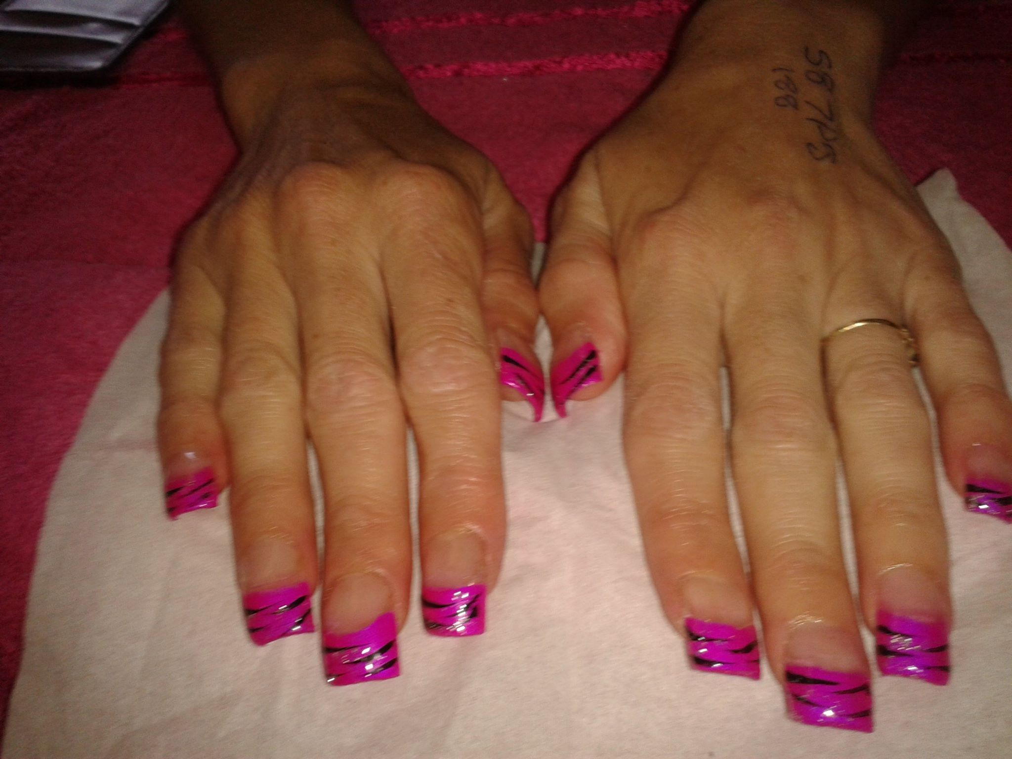 acrylic nail extensions with pink china glaze polish and black ...
