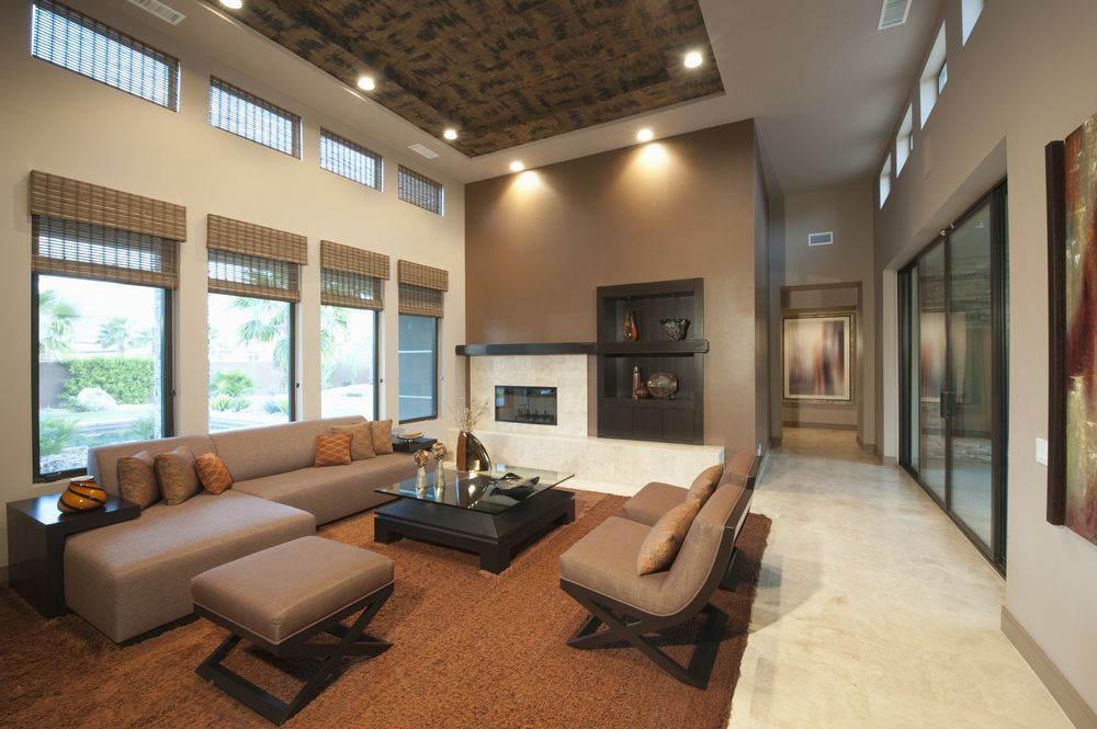 Another Modern Living Room Featuring Expansive Windows, This One Features  Orange Rug With Sectional Furniture