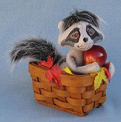 Annalee Doll Description: Open eyes - as shown, black and white hair and tail, grey body, holds red apple, in basket accented with fall leaves.