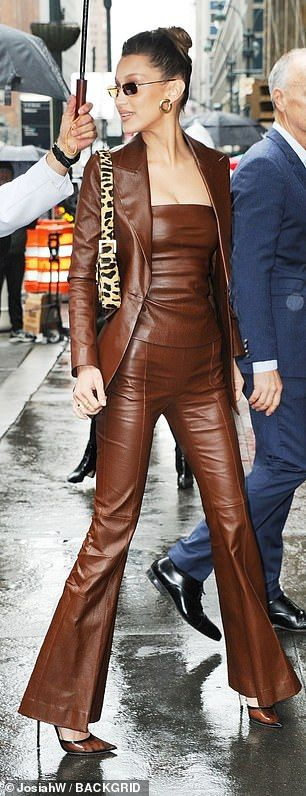 Gigi Hadid stuns in satin suit as Bella rocks leather couture