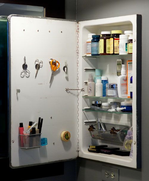 An Organized Medicine Cabinet Using Magnets On The Inside Of The