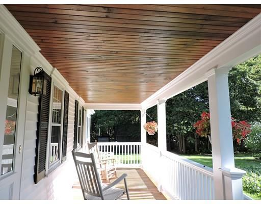 white house and porch with wood ceiling
