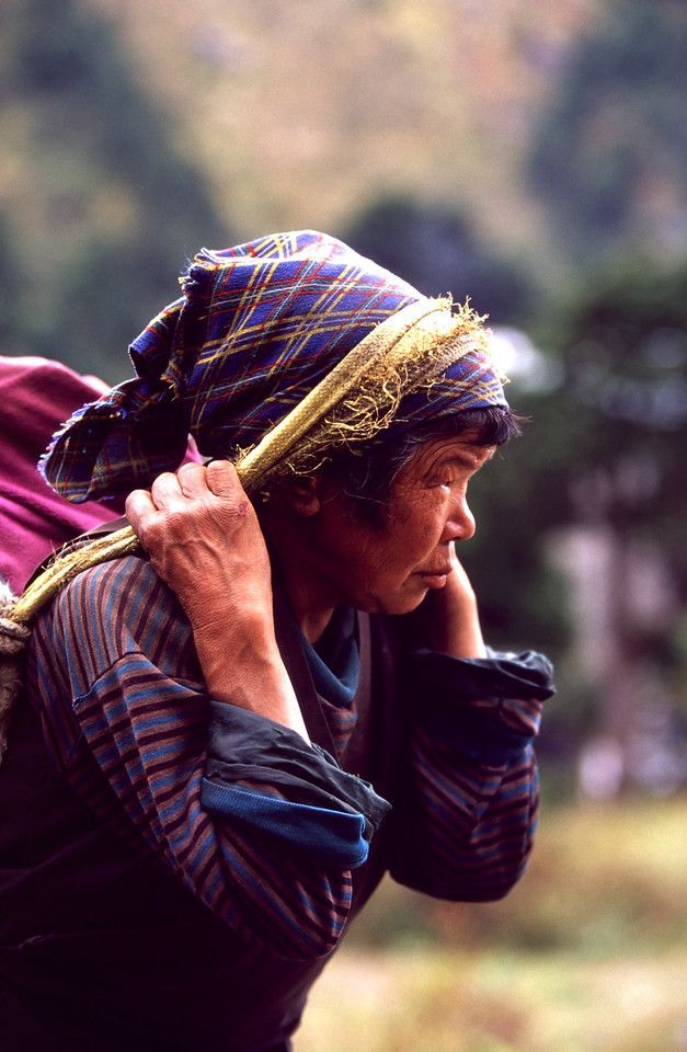 Female porter with a heavy load, Tengboche Monastery, Everest Region, Nepalese Himalaya, #Nepal #portrait #travel Nepal Travel  Honeymoon Backpack Backpacking Vacation South Asia Budget Off the Beaten Path  Trekking Bucket List #travel #honeymoon #vacation #backpacking #budgettravel  #offthebeatenpath #bucketlist #wanderlust #Nepal #Asia #southasia #exploreNepal  #visitNepal #seeNepal #discoverNepal #TravelNepal