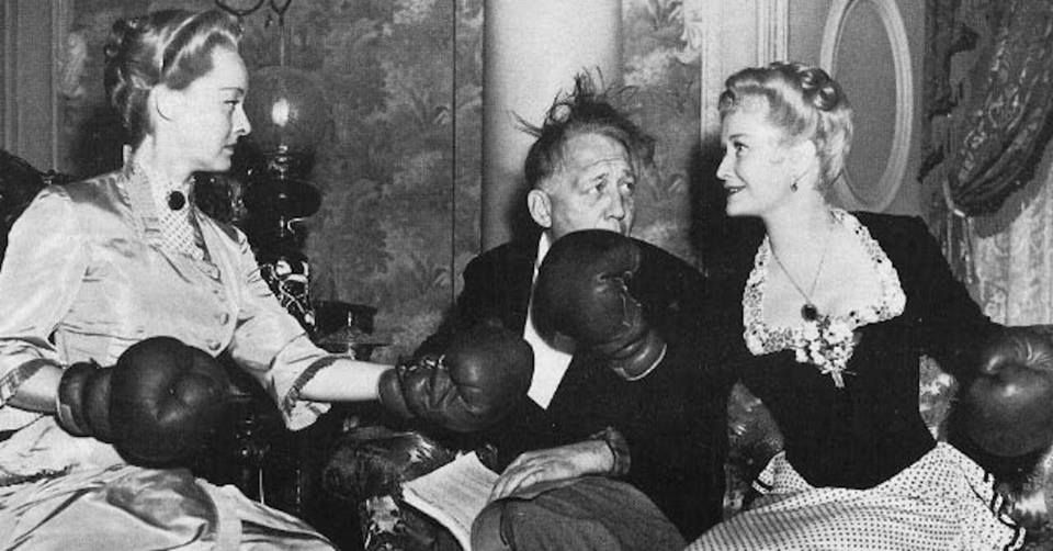 """sunsetgun: """" How have I managed to go through life without ever seeing this picture of Bette Davis and Miriam Hopkins on the set of The Old Maid wearing boxing gloves? """""""