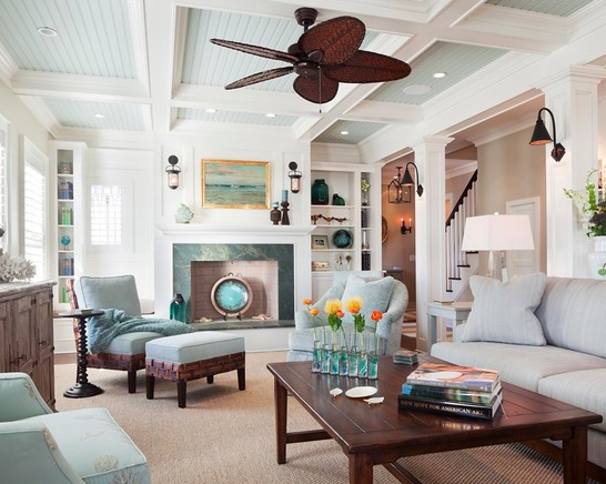 Beautiful coffered ceiling, paneling, moldings and columns in this beachside home.