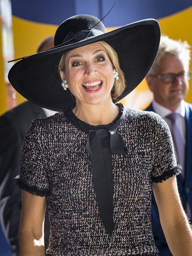Queen Maxima of Holland wore a wool dress with a bow at the neck with her  customary broad-brimmed hat as she arrived in Rotterdam today for the fifth  ... 51981a408b32